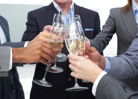 Close-up of business team toasting with Champagne