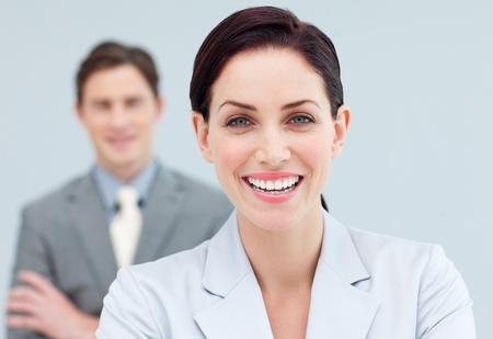 Cheerful business people standing in a row