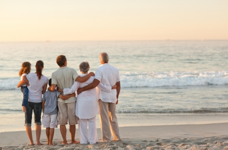 Foto de Beautiful family at the beach - Imagen libre de derechos