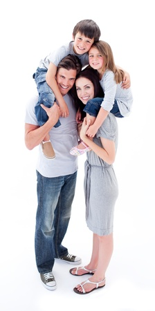 Photo for Cheerful parents giving their children piggyback ride - Royalty Free Image