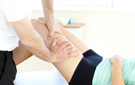 Close-up of a woman receiving a leg massage