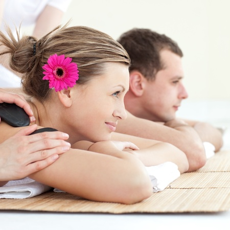 Cheerful young couple enjoying a Spa treatment