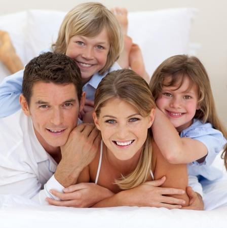 Photo pour Happy family having fun together - image libre de droit