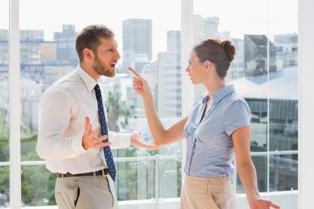 Foto de Business team having a heated argument in a bright office - Imagen libre de derechos
