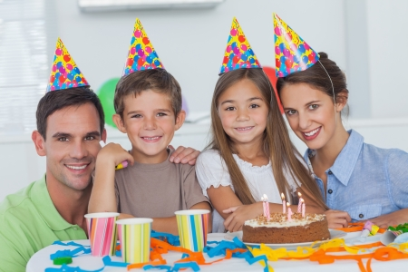 Family wearing party hat and celebrating a birthday