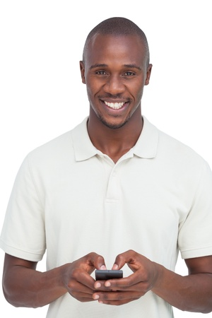 Smiling man using his mobile phone on a white background