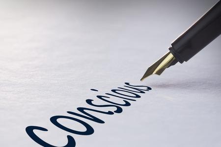 Foto de Fountain pen writing the word conscious - Imagen libre de derechos