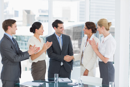 Photo for Handshake to seal a deal after a job recruitment meeting in an office - Royalty Free Image