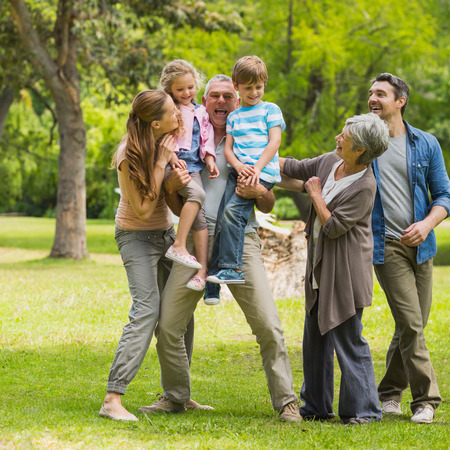 Photo for Full length of an extended family playing in the park - Royalty Free Image