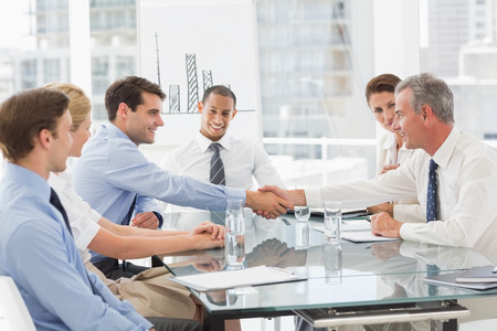 Photo for Business people making a deal at a meeting in the office - Royalty Free Image