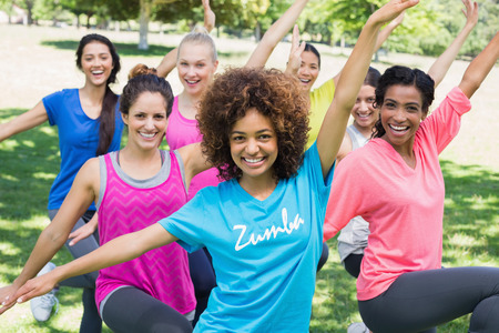 Photo for Portrait of smiling women performing fitness dance in park - Royalty Free Image