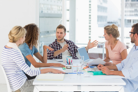 Foto de Young design team having a meeting together in creative office - Imagen libre de derechos