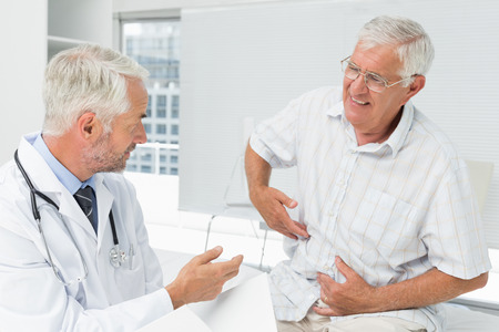 Photo for Male senior patient visiting a doctor at the medical office - Royalty Free Image