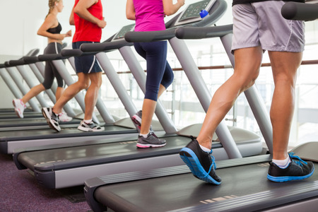 Foto per Row of people on treadmills at the gym - Immagine Royalty Free