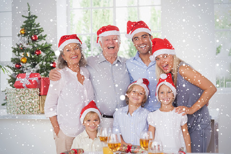 Composite image of Family posing for photo against snow falling