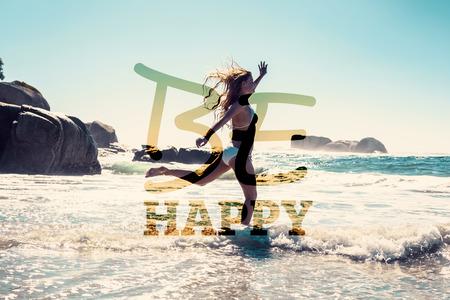 Foto de Beautiful smiling woman in white bikini skipping on the beach against be happy - Imagen libre de derechos