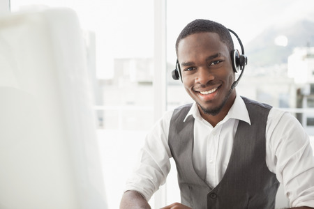 Photo for Happy businessman with headset interacting in his office - Royalty Free Image