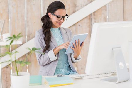 Stylish brunette working from home in her home office