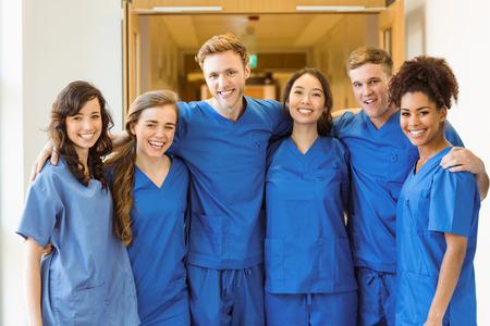 Foto de Medical students smiling at the camera at the university - Imagen libre de derechos