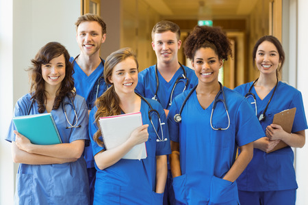 Medical students smiling at the camera at the university