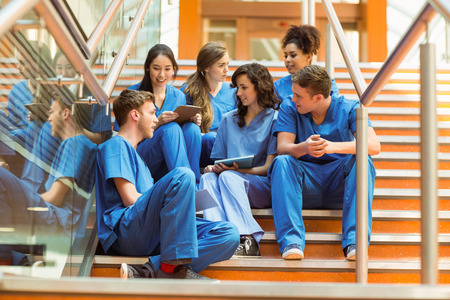 Photo for Medical students taking a break on the steps at the university - Royalty Free Image