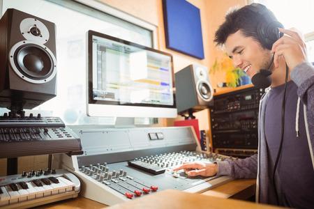 Photo pour Portrait of an university student mixing audio in a studio of a radio - image libre de droit