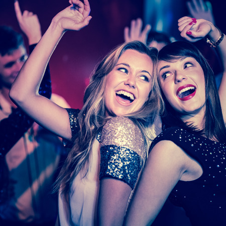 Foto de Happy friends having fun together at the nightclub - Imagen libre de derechos