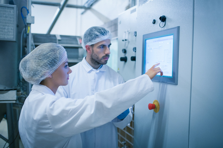 Photo for Food technicians working together in a food processing plant - Royalty Free Image