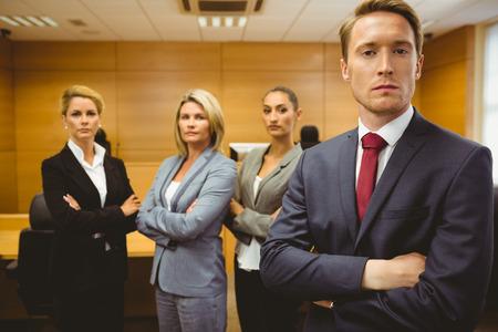 Foto de Serious lawyer standing with arms crossed in the court room - Imagen libre de derechos