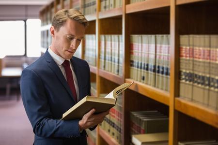 Foto de Handsome lawyer in the law library at the university - Imagen libre de derechos