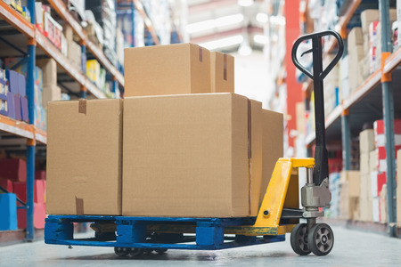 Photo for Cardboard boxes on trolley in warehouse - Royalty Free Image