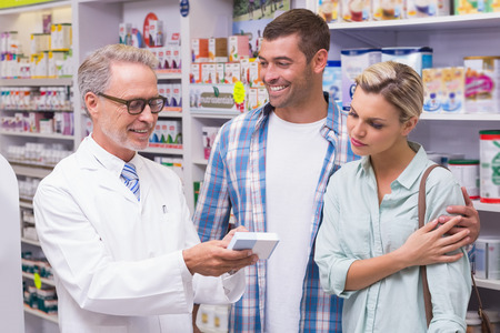 Photo for Pharmacist and costumers smiling at pharmacy - Royalty Free Image