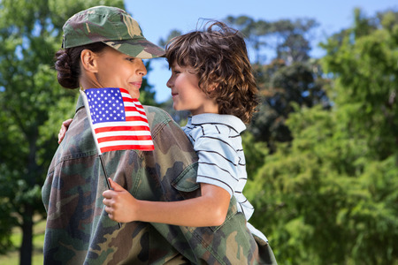 Photo for Soldier reunited with her son on a sunny day - Royalty Free Image
