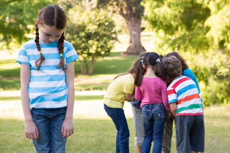 Photo for Little girl feeling left out in park on a sunny day - Royalty Free Image