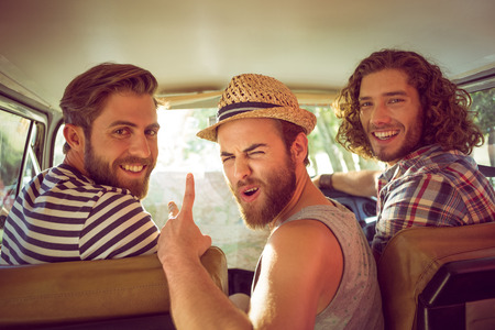Photo pour Hipster friends on road trip on a summers day - image libre de droit