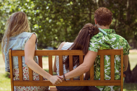 Foto de Young man holding hand of wrong girl on a summers day - Imagen libre de derechos