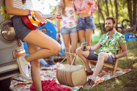 Photo for Hipsters having fun in their campsite at a music festival - Royalty Free Image