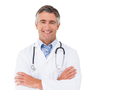 Photo for Happy doctor smiling at camera on white background - Royalty Free Image