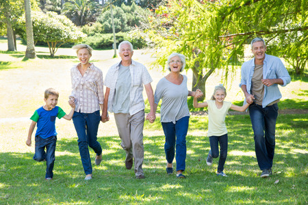 Foto de Happy family running in the park on a sunny day - Imagen libre de derechos