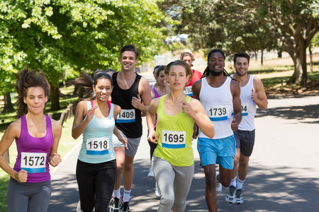 Photo pour Happy people running race in park on a sunny day - image libre de droit