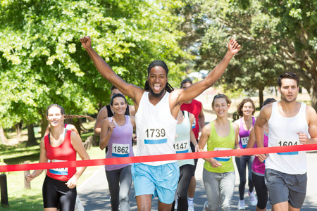 Photo pour Fit people running race in park on a sunny day - image libre de droit