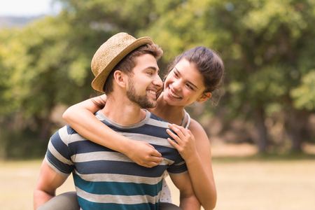 Photo for Cute couple in the park on a sunny day - Royalty Free Image