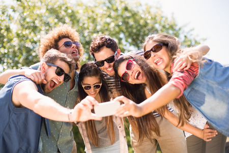 Photo for Happy friends in the park taking selfie on a sunny day - Royalty Free Image
