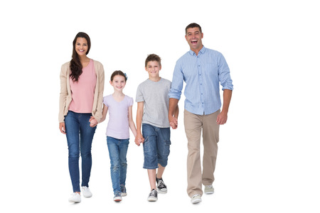 Photo pour Full length portrait of happy family walking over white background - image libre de droit