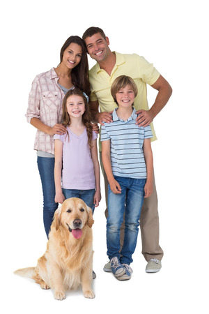 Photo pour Portrait of happy family standing with dog over white background - image libre de droit