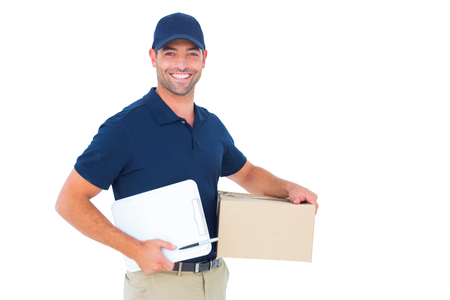 Photo pour Portrait of happy delivery man with cardboard box and clipboard on white background - image libre de droit