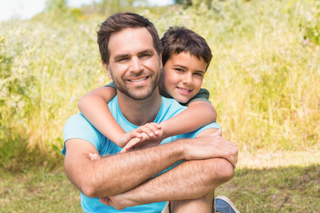 Photo for Father and son in the countryside on a sunny day - Royalty Free Image