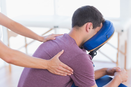 Foto de Man having back massage in medical office - Imagen libre de derechos