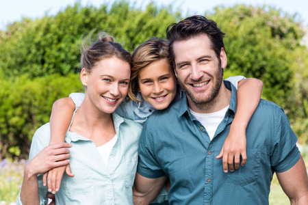 Photo for Happy family smiling at camera in the countryside - Royalty Free Image