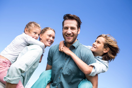 Photo for Happy parents with their children in the countryside - Royalty Free Image